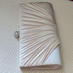 cream colored clutch purse